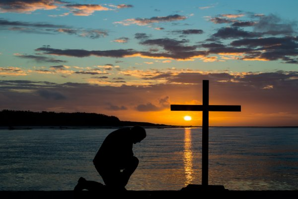depositphotos_127602798-stock-photo-kneeling-before-the-cross.jpg